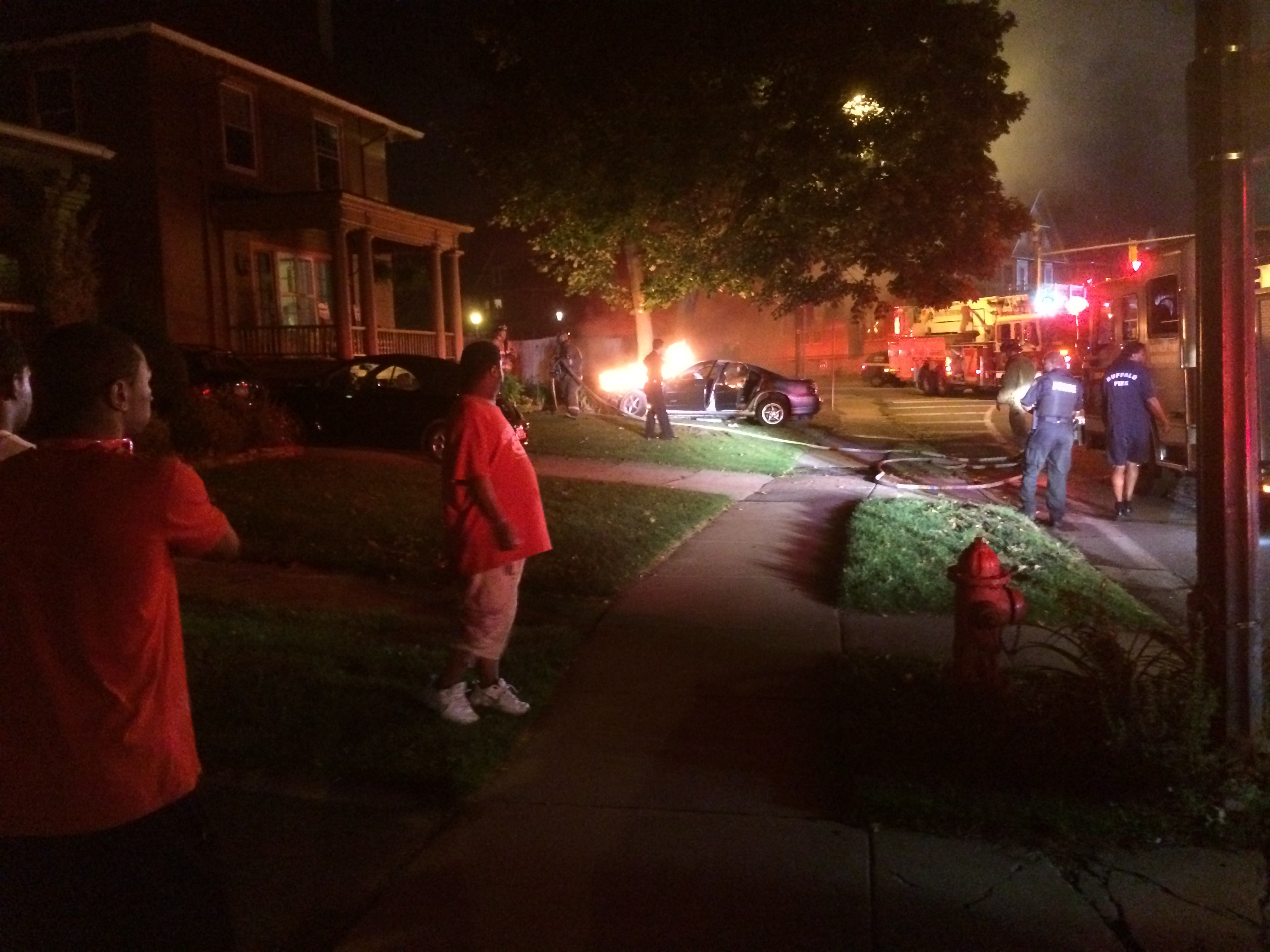 car on fire on the lawn Aug 2014
