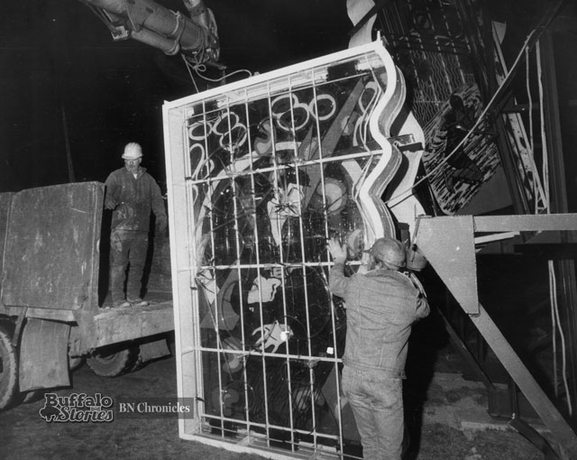 A city contractor dismantles Green Lightning. (Buffalo News archives)