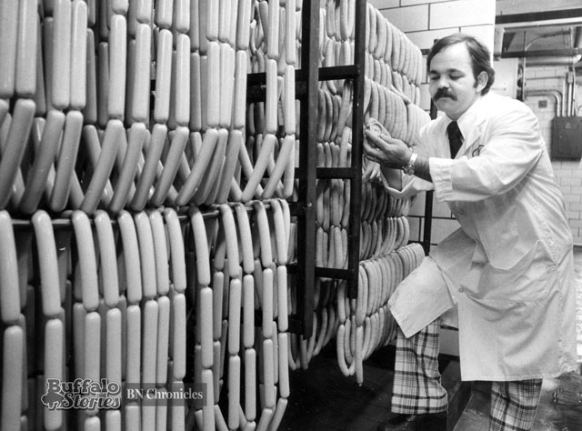 Inspecting a Sahlen smokehouse hot dog, 1977. (Buffalo News archives)