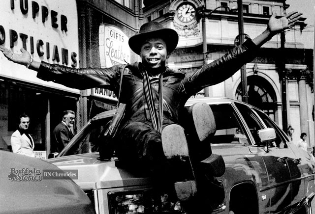 Rick James sits on the hood of his Cadillac in front of the Buffalo Savings Building, 1977. (Buffalo News archives)