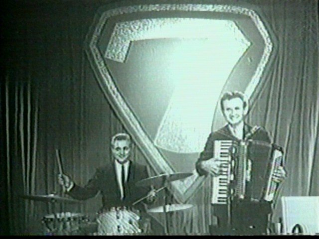 "Jimmy Edwin, drums, and Johnny Banaszak, accordion, on the set of ""Dialing for Dollars."" Banaszak was also the man inside the Promo the Robot costume on ""Rocketship 7."""