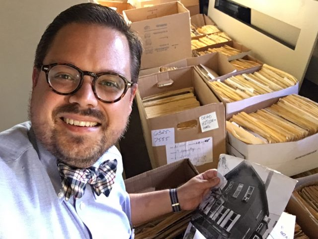 Steve Cichon looks through boxes of files for BN Chronicles materials. (Buffalo Stories photo)