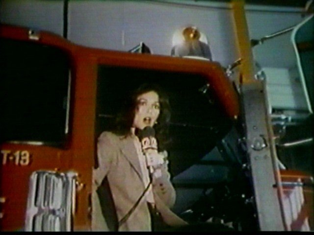 Susan Banks on a fire truck