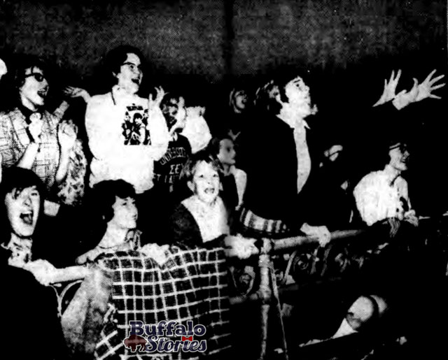 Girls scream for The Beatles on the big screen at the Paramount Theatre, March, 1964. Buffalo Stories archives