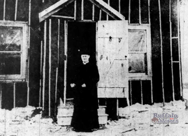 Rev. Thomas Timmons stands in front of the temporary St. Margarets Church on Hertel Ave., 1917. Buffalo Stories archives