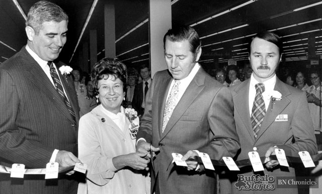 Cutting the ribbon on Twin Fairs tenth store, on Maple Road in Amherst. The site is now home to Tops. In the photo are Harold Egan, Twin Fair President; Edith McArdle, Twin Fair employee since 1958; Al Dekdebrun, Amherst Supervisor, sporting goods retailer, and 1946 Buffalo Bisons quarterback; and Andy Heferle, store manager.