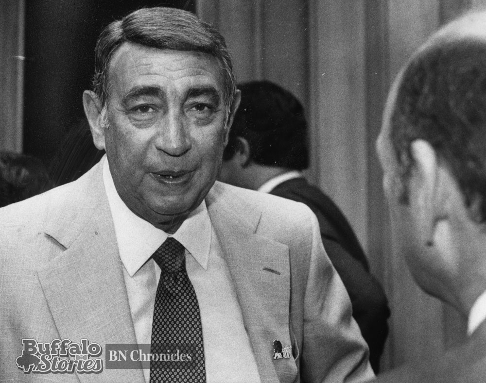 "Howard Cosell, wearing a ""Talking Proud"" pin, speaks with Buffalo Mayor James D. Griffin. (Buffalo Stories archives)"