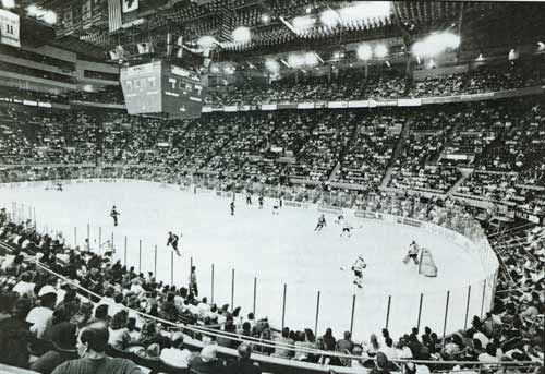 """The Aud Complete with scoreboard, overhang Oranges, and """"Cigarette Butt"""" Sound Baffles hanging fromt he ceiling."""