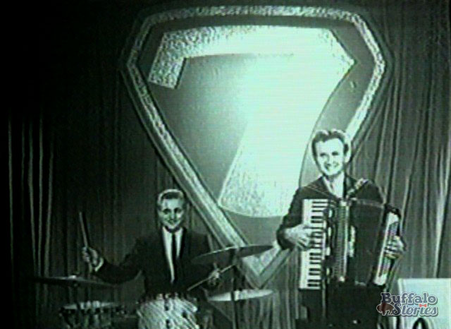 Jimmy Edwin, drums, and Johnny Banaszak, accordion, on the set of Dialing for Dollars. Banaszak was also the man inside the Promo the Robot costume on Rocketship 7.